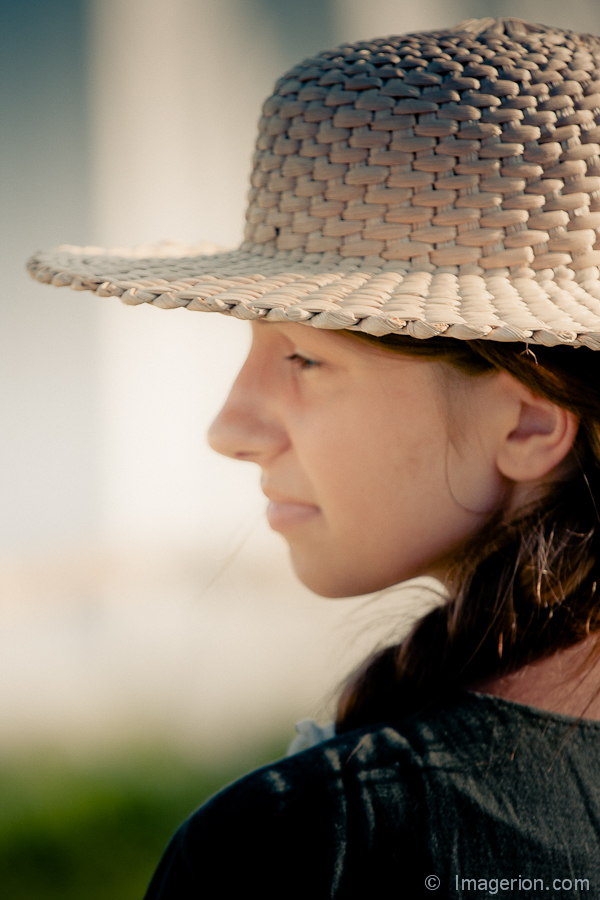 Portrait in a straw hat