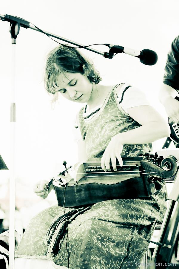Woman plying hurdy gurdy