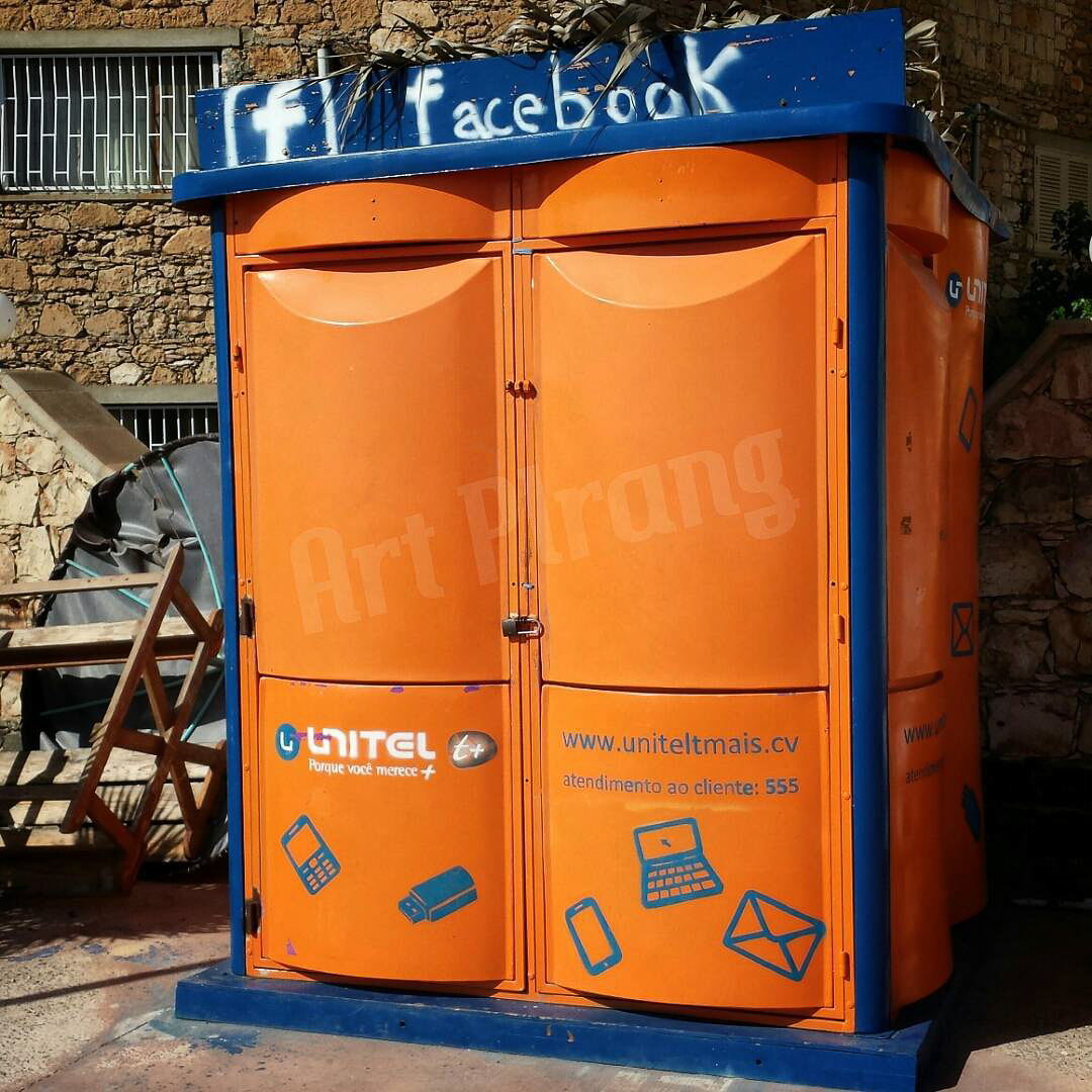 Orange blue kiosk with Facebook logo painted on