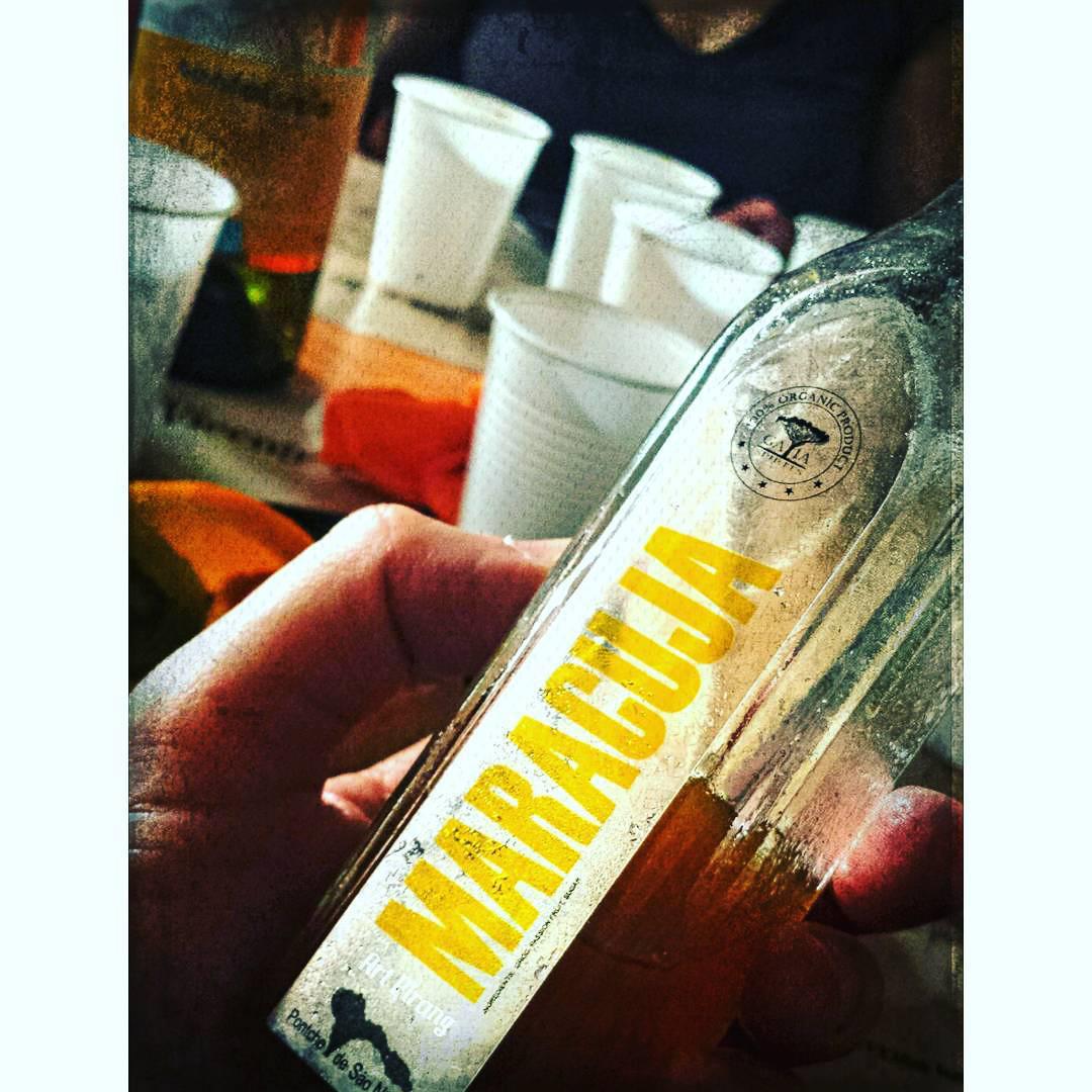 Holding a Maracuja liqueur bottle