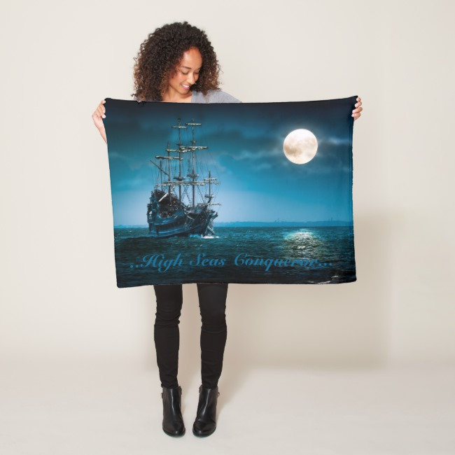 Woman holding a blanket with the pirate ship