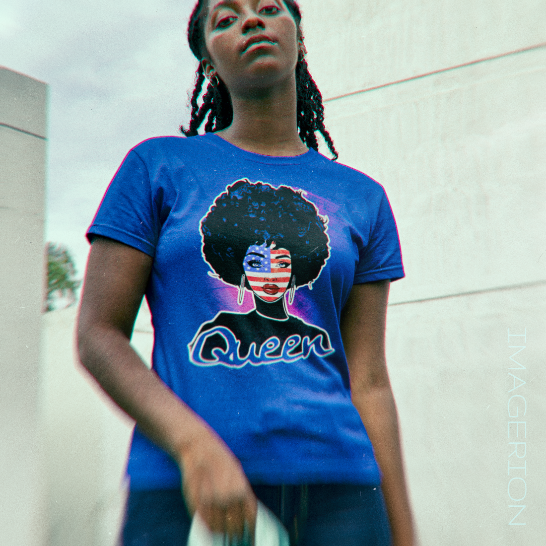 Black woman wearing an blue T-shirt with black woman portrait, face painted with a USA Flag, Queen text at the bottom