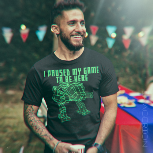 Man wearing a T-shirt with a green retro style mech rendering
