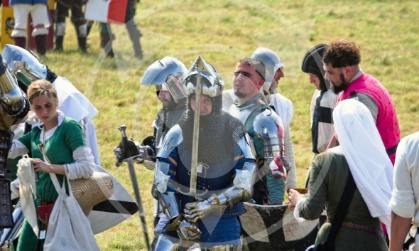 Knights and crusaders tired after the Battle of Grunwald 1410 reenactment