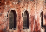 Image of brickwall. Barred windows in a brick wall