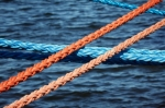 Image of sailing. Mooring ropes securing ships