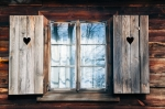Image of window. Old window shutters in  wooden wall