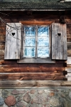 Image of window. Rustic shutters