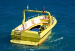 Image of motorboat. Yellow motorboat without people
