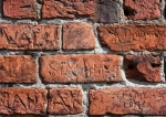 Image of bricks. Inscriptions chiselled bricks wall