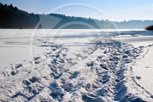 Frozen lake snow trails
