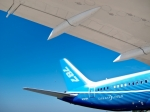 Image of Boeing. Tail and wing of Boeing 787 Dreamliner