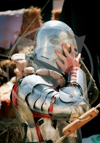 Armored Knight wearing helmet on
