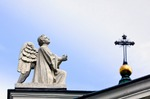 Image of angels. Angel praying and the Holy Cross