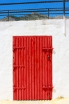 Image of closed. Red door of metal