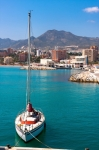 Image of sailing. Sailboat with sails lowered, Benalmadena Coast, Spain