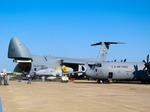 Image of aircraft. Lockheed C-5 Galaxy  and C-130 Hercules aircrafts