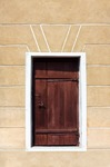 Image of door. Wooden door in a wall