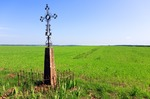 Image of christian. Wayside Cross in a field