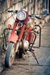 Image of bike. Old red and rusty vintage motorbike