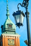 Image of lantern. Vintage lantern and Royal Castle in Warsaw