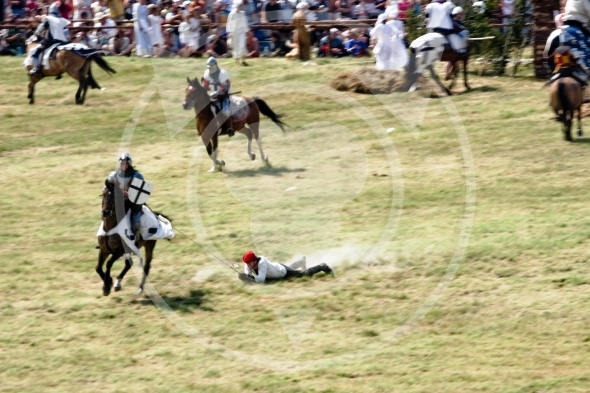 Peasant dragged by a horse