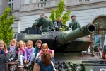 Image of Leopard. Leopard 2 tank and  children
