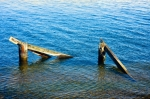 Image of pier. Wooden pier remnants in sea water