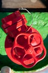 Image of knob. Water valve red knob
