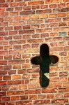 Image of cross. Cross in old brick wall