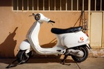 Image of bike. Old white Vespa scooter