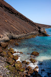 Image of shoreline. Extinct volcano crater, sharp boulders, basalt ocean shore line. Sao Vicente Island in Cape Verde