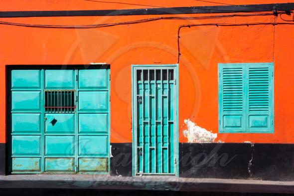 Orange wall, cyan windows and door