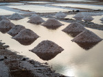 Image of salt. Cape Verde, salt heaps in salt water ponds