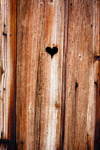 Image of heart. Heart of love on wooden boards of an old window shutter