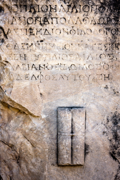 Ancient text letters carved in a stone wall in Selcuk / Turkey