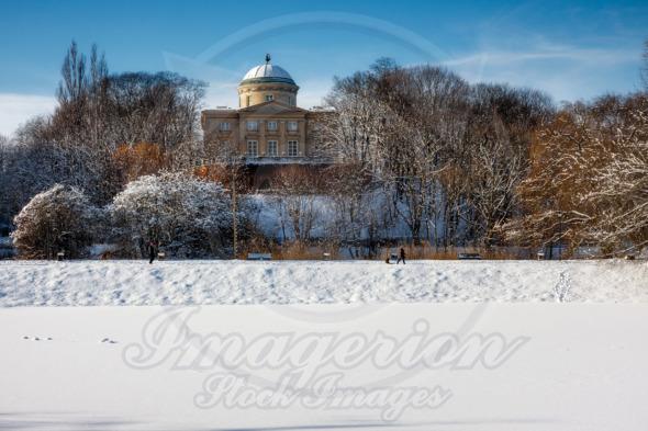 Frozen park ponds in Warsaw below the The Rabbit House Palace / Krolikarnia