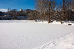 Image of snow. Frozen lake covered with snow near Krolikarnia Palace