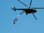 Image of GROM. GROM Special Forces hanging from a helicopter