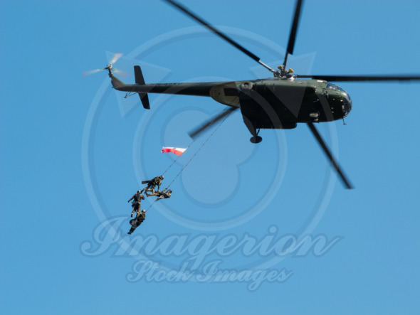 GROM Special Forces hanging from a helicopter