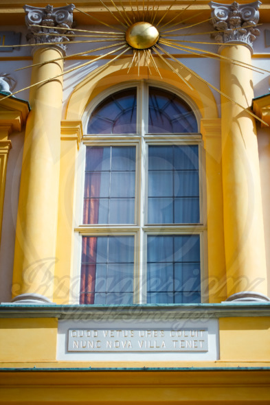 Window of the Royal Palace with golden Sun rays, Wilanów in Warsaw