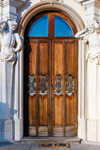 Image of door. Door with atlants at the baroque Wilanow Royal Palace in Warsaw