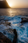 Image of sunset. Dusty sunset and turbulent waves, Ponta do Sol, Cape verde