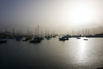 Image of mist. Boats and yachts in port of Sao Vicente, Cabo Verde