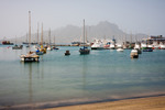 Image of harbor. Mindelo boats and yachts in Marina. Visible Face Mountain