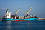 Image of freight. Maersk Line cargo container ship Volta in port of Sao Vicente, Cape Verde