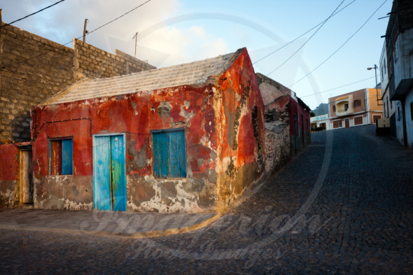 Historic red house crumbling near port of Ponta Do Sol, Cape Verde