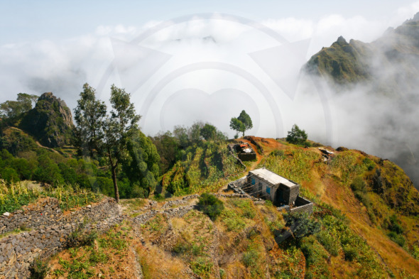 Hilly rural landscape in clouds. Santo Antao farmlands, Cape Verde