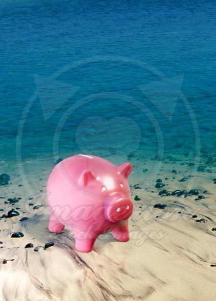 Piggy bank at the sea shore, saving money concept