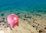 Image of earn. Pink piggy bank on the beach, saving money concept